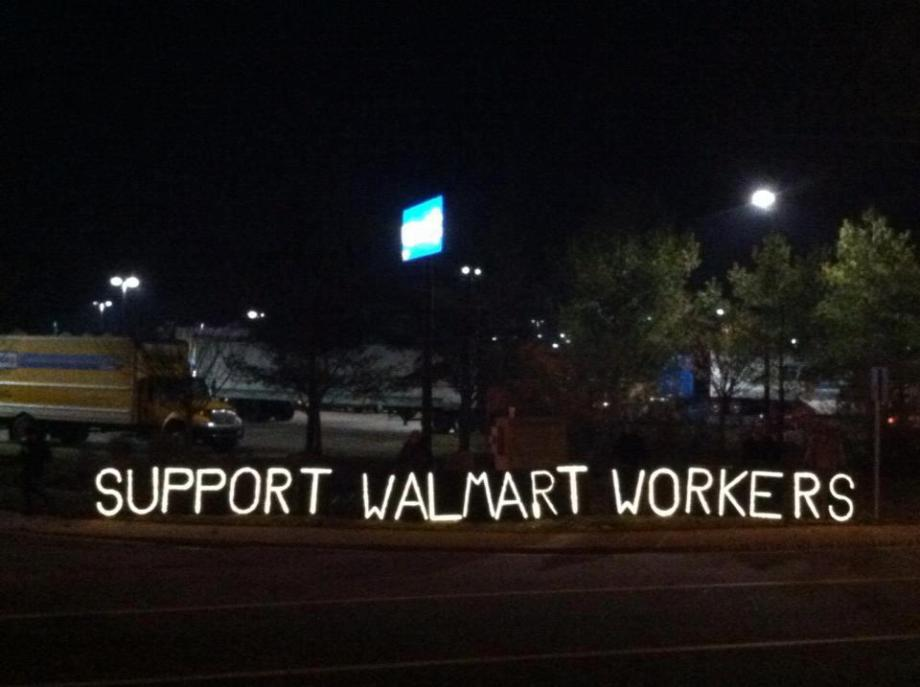 Support Walmart workers - one of the messages of protests (Photo courtesy by Overpass Light Brigade )